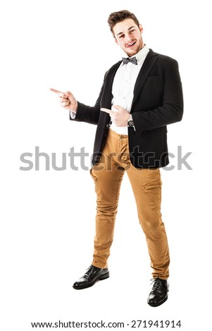 a handsome young man or hipster with braces and a bow tie isolated over a white background - stock photo