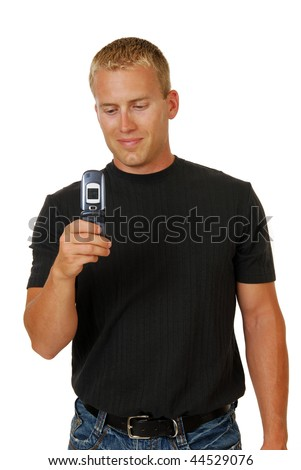 A handsome young man with a cell phone camera - stock photo