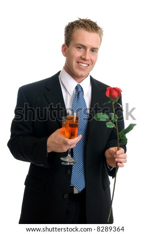 A handsome young man with wine and roses - stock photo