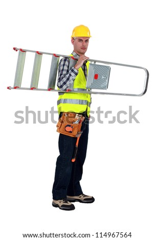 A handyman carrying a ladder. - stock photo