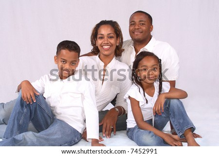 A happy African American family posed together
