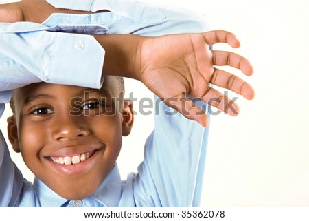 a happy attractive boy with a beautiful smile - stock photo