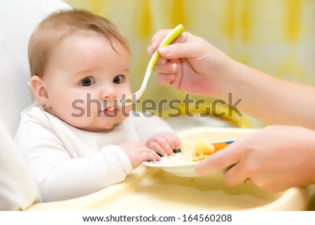 A happy baby feeding - stock photo