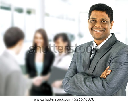 A happy black business man with people in the background
