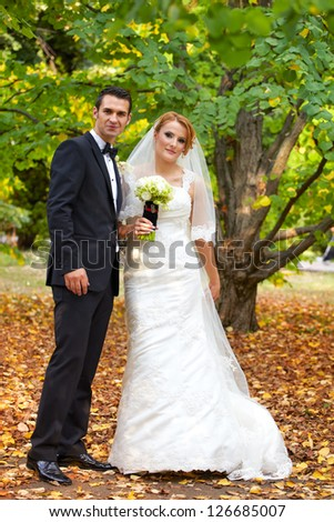 A happy bride and groom together outside on their wedding day