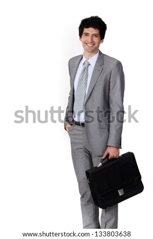 A happy businessman with a briefcase. - stock photo