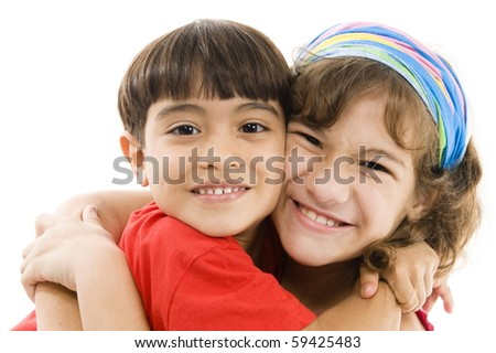 A Happy Child giving a hug in other one.