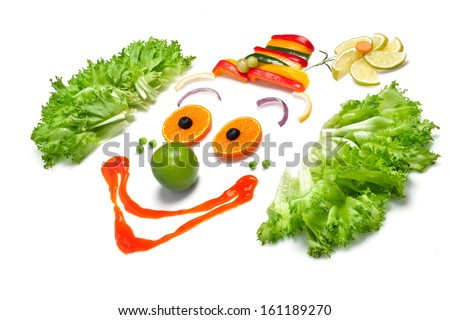A happy clown made of fruits and vegetables. - stock photo