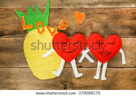A happy couple in love with  smiles over wooden background - stock photo