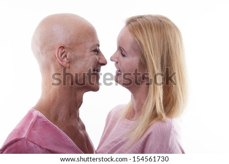 A Happy Couple Laughing and Standing Close to Each Other, Isolated - stock photo