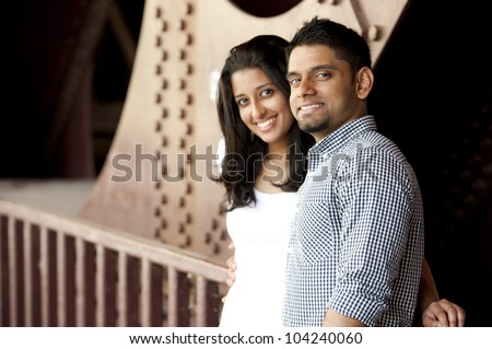 A happy couple looking out into the new world. - stock photo