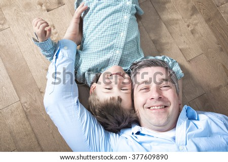 A Happy dad and son. Top view of happy father and son  - stock photo