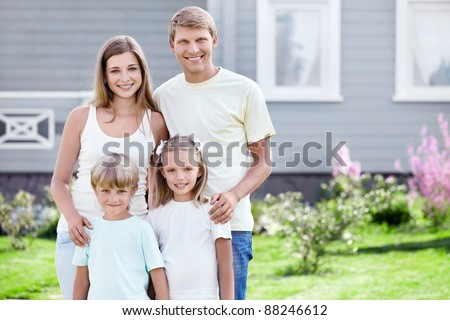 A happy family around the house - stock photo