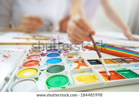 a happy family is painting - stock photo
