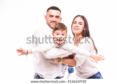A happy family: mother, father and son on white background - stock photo