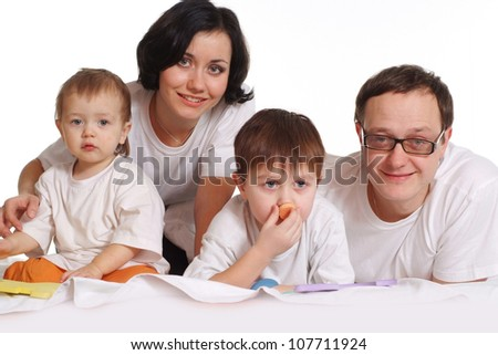 A happy family of four on a white background