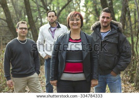 A Happy family of mother with three son