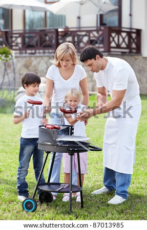 A happy family with a barbecue - stock photo