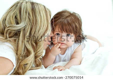 A happy family. young mother with baby girl - stock photo