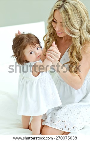 A happy family. young mother with baby girl