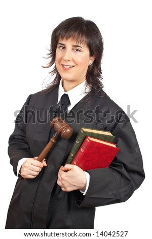 A happy female judge holding the gavel and books. Shallow depth of field
