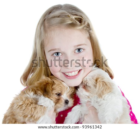 a happy girl hugging two small fluffy puppies, isolated on a white background