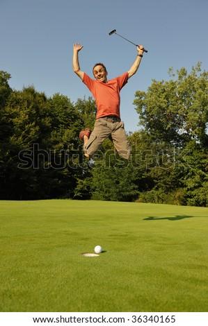 A happy golfer - stock photo