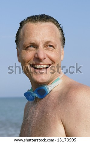 A happy laughing 44 year old man. - stock photo
