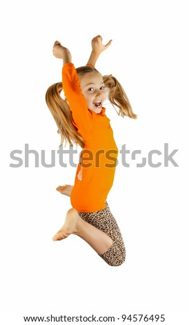 a happy little girl jumps and plays - stock photo