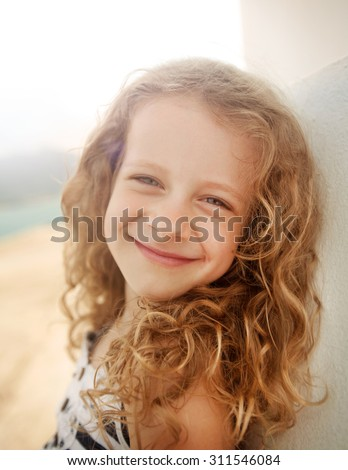 a happy little girl smiling portrait - stock photo