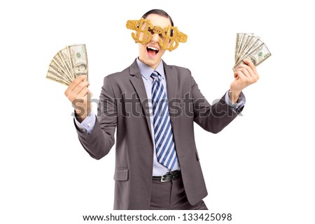 A happy man wearing dollar sign glasses and holding US dollars isolated on white background - stock photo