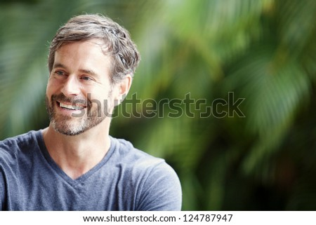 A happy mature man smiling