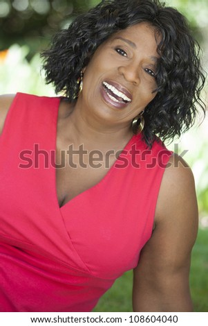 A happy senior African American woman outside smiling. - stock photo