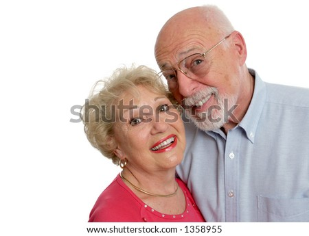 A happy senior couple who is young at heart.  Isolated with room for text. - stock photo