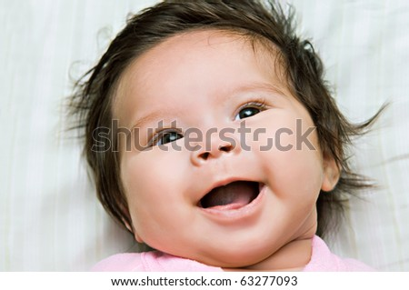 A happy smiling infant baby girl