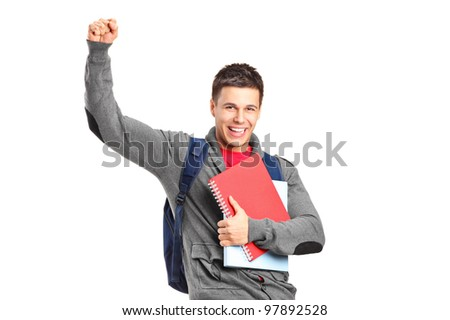A happy student holding books and gesturing isolated on white background - stock photo
