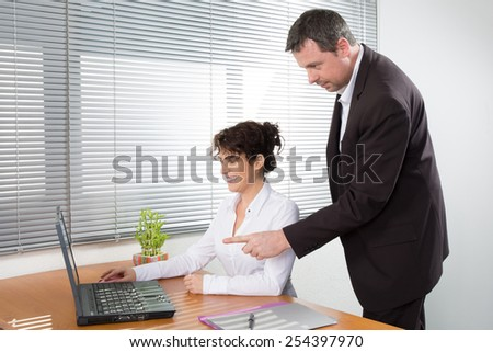 A Happy successful business team or partners with a smiling man and woman - stock photo