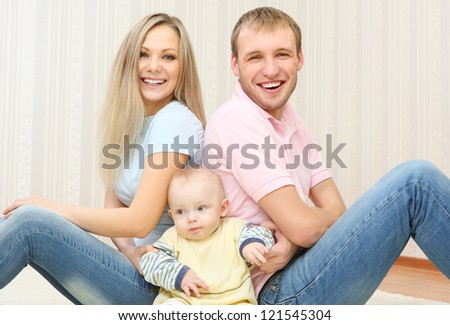 A happy young couple  at home - stock photo