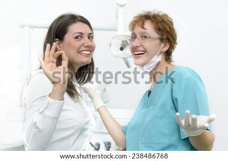 A happy young girl visiting her dentist - stock photo