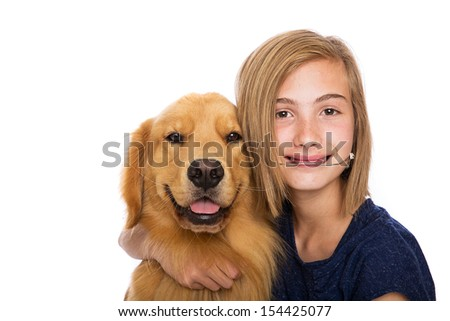 A happy young girl wearing headgear sits with her dog