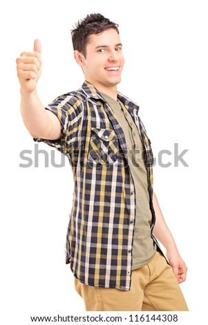 A happy young male giving a thumb up isolated on white background