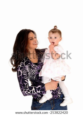A happy young mother holding her baby girl in her arms, isolated