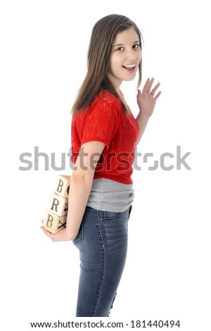 """A happy young teen waving good-bye as she holds alphabet blocks showing the letters """"BRB"""" (be right back).  On a white background.   - stock photo"""