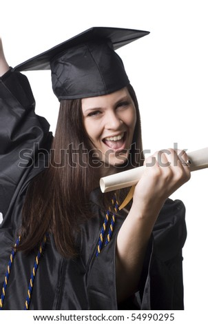 A happy young woman in graduation cap and gown celebrating with her diploma in hand.