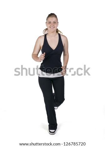 A happy young woman jogs towards the camera
