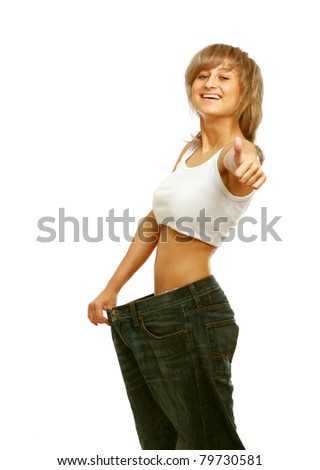 A happy young woman showing how much she lost, isolated on white