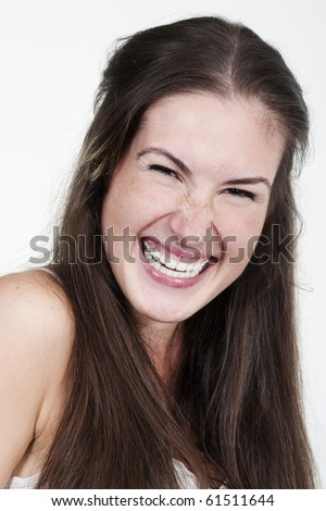 A happy young woman with big smile on white background - stock photo