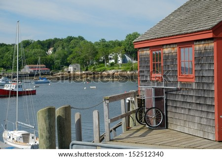 A harbor master shack on the edge of a harbor in a classic New England town - stock photo
