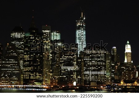 A harbor view of the city at night. - stock photo