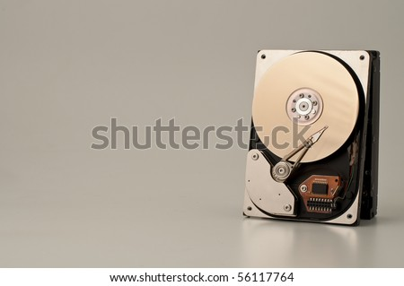 A hard disk isolated on brown background - stock photo